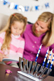 Hanukkah: Focus on Menorah and Dreidel royalty free stock photos