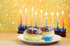Hanukkah holiday sufganiyot with menorah on wooden table Stock Photo