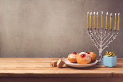 Hanukkah holiday sufganiyot and menorah on wooden table Stock Photos