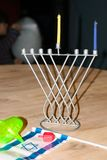 Hanukkah. The Israeli flag. Dreidl. Macro photography. Stock Image