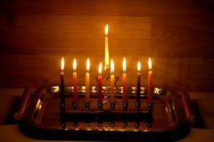 Hanukkah is a Jewish holiday. Burning Chanukah candlestick with candles. Chanukiah Menorah.  stock image