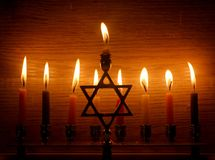 Hanukkah is a Jewish holiday. Burning Chanukah candlestick with candles. Chanukiah Menorah.  royalty free stock images