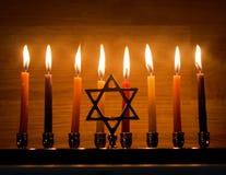 Hanukkah is a Jewish holiday. Burning Chanukah candlestick with candles. Chanukiah Menorah.  royalty free stock image