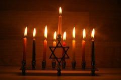 Hanukkah is a Jewish holiday. Burning Chanukah candlestick with candles. Chanukiah Menorah.  stock images