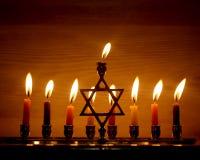 Hanukkah is a Jewish holiday. Burning Chanukah candlestick with candles. Chanukiah Menorah.  royalty free stock photo