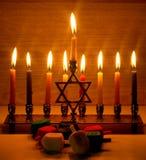 Hanukkah is a Jewish holiday. Burning Chanukah candlestick with candles. Chanukiah Menorah. dreidel, savivon.  stock photography