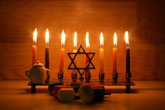 Hanukkah is a Jewish holiday. Burning Chanukah candlestick with candles. Chanukiah Menorah. dreidel, savivon.  royalty free stock photos