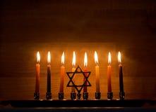 Hanukkah is a Jewish holiday. Burning Chanukah candlestick with candles. Chanukiah Menorah.  royalty free stock photography