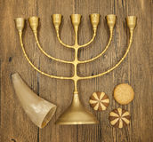 Hanukkah is the Jewish New Year. Candle with Christmas ornaments and cookies horn on wooden background Stock Image