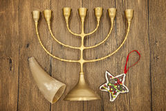 Hanukkah is the Jewish New Year. Candle with Christmas ornaments and cookies horn on wooden background Stock Photography