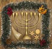 Hanukkah is the Jewish New Year. Candle with Christmas ornaments and cookies horn on wooden background Royalty Free Stock Photos