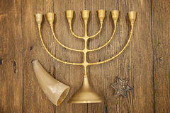 Hanukkah is the Jewish New Year. Candle with Christmas ornaments and cookies horn on wooden background Stock Photos