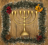 Hanukkah is the Jewish New Year. Candle with Christmas ornaments on the wooden background. Royalty Free Stock Photo