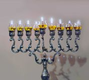 Hanukkah lamp. Burning olive oil rather than candles stock photo