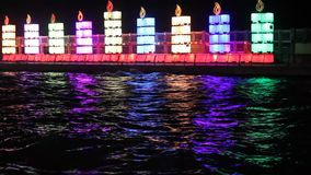 Hanukkah lights. The Jewish holiday of Hanukkah. Menorah in the port of Tel Aviv stock footage