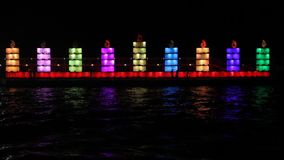 Hanukkah lights. The Jewish holiday of Hanukkah. Menorah in the port of Tel Aviv stock video