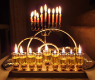 Hanukkah lights. Oil lamp and candles Stock Photography