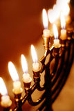 Hanukkah Menorah. Brightly glowing Hanukkah menorah. Shallow depth of field royalty free stock photography