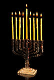 Hanukkah menorah. Candles in Hanukkah menorah on the eighth night of the festival Royalty Free Stock Photography