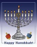 Hanukkah menorah with burning candles. Hanukkah menorah with burning candle and dreidels Stock Images