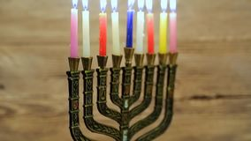 Hanukkah menorah with burning candles. Retro old style. Filtered photo stock video