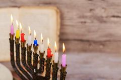 Hanukkah menorah with burning candles. Retro old style. Filtered photo Stock Photos