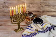 Hanukkah menorah with burning candles. Retro old style. Filtered photo Royalty Free Stock Images