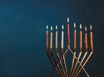 Hanukkah menorah with candles for chanukah celebrationon black background. Menorah for Hanukkah celebration with candles for chanukah on black background royalty free stock images