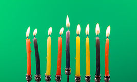 Hanukkah menorah with candles green background isolation Stock Images