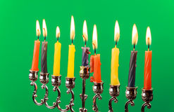Hanukkah menorah with candles green background isolation Royalty Free Stock Photos