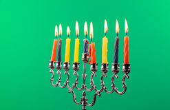 Hanukkah menorah with candles green background isolation Royalty Free Stock Photo