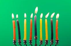 Hanukkah menorah with candles green background isolation Royalty Free Stock Photos