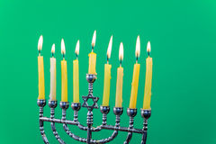 Hanukkah menorah with candles green background isolation Royalty Free Stock Images
