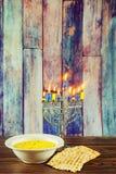 Hanukkah menorah with candles matzo soup Stock Photo
