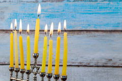 Hanukkah menorah with candles and silver dreidel. Stock Photo