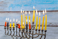 Hanukkah menorah with candles and silver dreidel. Stock Photography
