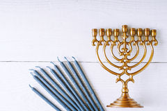 Hanukkah menorah and candles on the white wooden table top view Royalty Free Stock Images