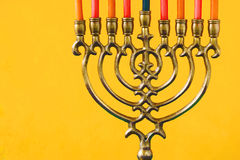 Hanukkah menorah with candles on the yellow background horizontal Royalty Free Stock Photography