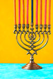 Hanukkah menorah with candles on the yellow background vertical Royalty Free Stock Photo