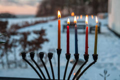 Hanukkah menorah chanukkiah with candles. Beautiful Hanukkah menorah chanukkiah with glowing candles in a window stock photos