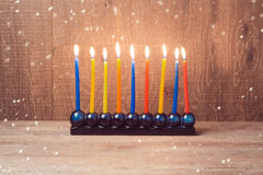 Hanukkah menorah with colorful candles over wooden background Royalty Free Stock Photos