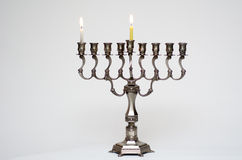 Hanukkah menorah on the first day of Hanukkah Stock Photos