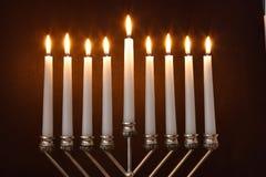 Hanukkah Menorah / Hanukkah Candles. Silver Hanukkah candles lit on the traditional Hanukkah menorah