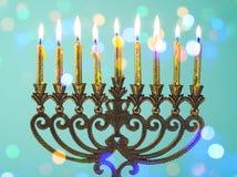 Hanukkah menorah. With golden candles and bokeh lights Stock Images