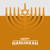 Hanukkah Menorah on Light yellow Background. Happy Hanukkah text typography. Royalty Free Stock Images