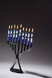 Hanukkah Menorah With Lit Candles. A silver Hanukkah menorah with lit blue and white candles stock photos