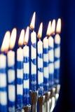Hanukkah: Menorah with Lit Candles. Simple Hanukkah menorah with candles royalty free stock images