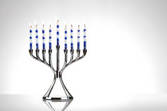 Hanukkah: Menorah With Lit Candles on White. Simple Hanukkah menorah with candles royalty free stock photography