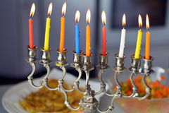 Hanukkah menorah. Lit with eight candles during dinner celebration at the last day of Hanukah stock image