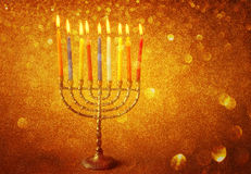 Hanukkah menorah over glitter background. Hanukkah menorah over gold glitter background